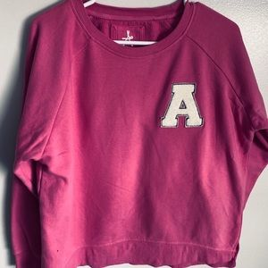 Pink sweater. Warm. Long sleeves.